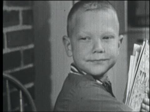 vídeos y material grabado en eventos de stock de b/w 1958 close up blonde boy at table looking to his side - 1958