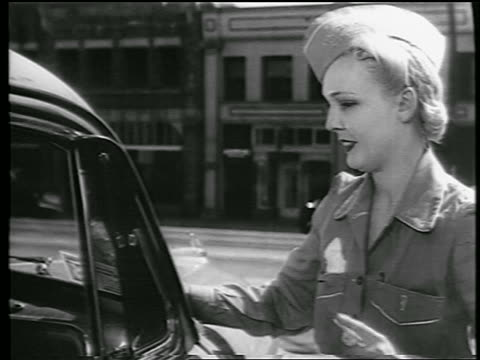 b/w 1944 close up blonde female gas station attendant cleaning windshield / industrial - gas station attendant stock videos and b-roll footage