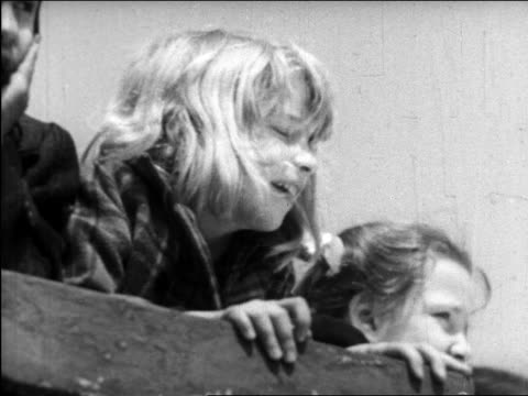 vidéos et rushes de b/w 1945 close up blonde girl looking down outdoors / nyc / educational - une seule petite fille