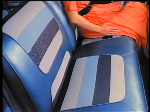 1958 close up blue + white front seat of car with woman sitting in driver's seat / commercial - 1958 stock-videos und b-roll-filmmaterial