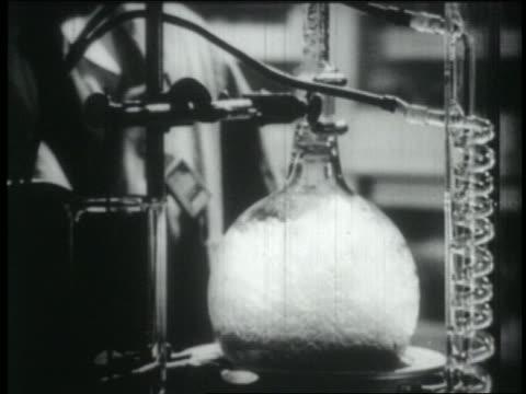 b/w 1965 close up boiling bunsen burner in lab - bunsen burner stock videos & royalty-free footage