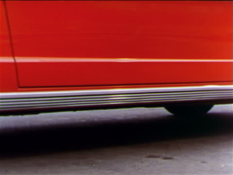 1965 close up pan bottom of red ford mustang to wheel / industrial - ford mustang stock videos and b-roll footage