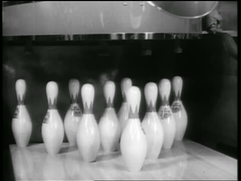 b/w 1938 close up bowling ball knocking over all pins (strike) / chicago / newsreel - bowling ball stock videos & royalty-free footage