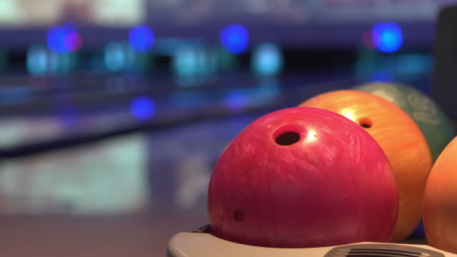 close up bowling ball return at alley. - bowling alley stock videos & royalty-free footage