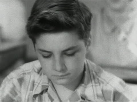1955 close up boy sneezing repeatedly, holding tissue up to nose / audio - hay fever stock videos & royalty-free footage