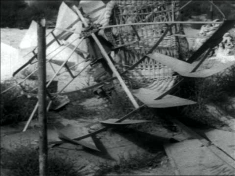 B/W 1936 close up broken windmill lying on ground
