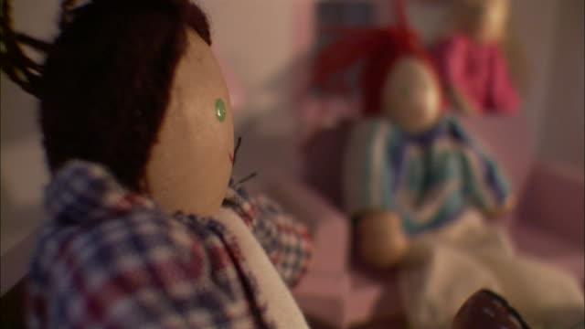 close up - brown recluse spider on yellow dollhouse furniture; near dolls /  - おもちゃの家点の映像素材/bロール