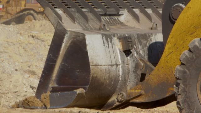 close up bulldozer bucket dumping dirt at a coal mine - bulldozer stock videos & royalty-free footage