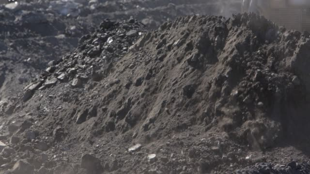 close up bulldozer moving dirt at a coal mine - bulldozer stock videos and b-roll footage