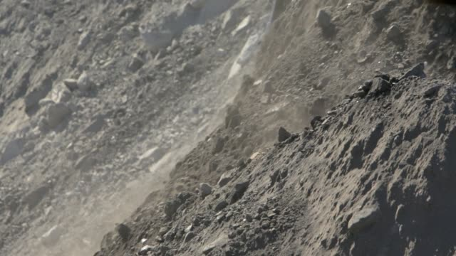 close up bulldozer moving dirt at a coal mine - digging stock videos and b-roll footage