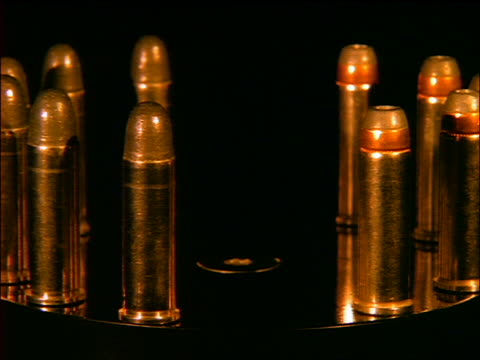 close up bullet shells turning / gold light - bullet stock videos and b-roll footage