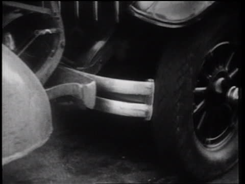 b/w 1939 close up bumper of car backing up + hitting fender of other car / nyc / documentary - bumper stock videos & royalty-free footage