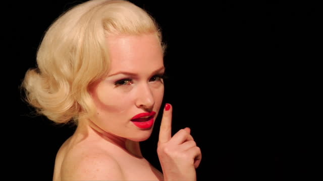 close up burlesque dancer turning and putting finger to lips - burlesque stock videos & royalty-free footage