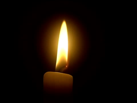 close up burning candle/ flame going out - ローソク点の映像素材/bロール