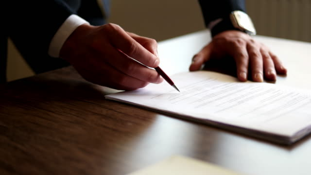 close up business man signing contract - writing activity stock videos & royalty-free footage