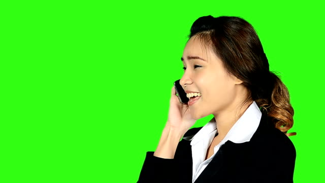 close up business woman talking telephone with green screen background - keyable stock videos & royalty-free footage