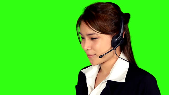 close up business woman wearing headphone with green screen background - keyable stock videos & royalty-free footage