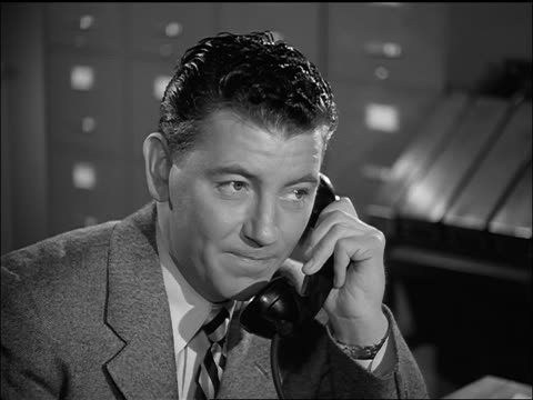 b/w 1952 close up businessman in office talking on telephone - 1952 stock videos & royalty-free footage