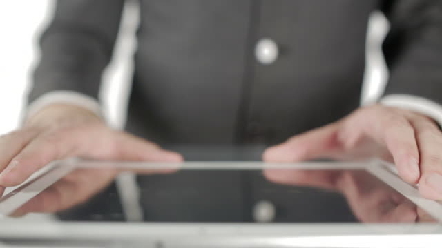 close up: businessman using digital tablet - one mid adult man only stock videos & royalty-free footage