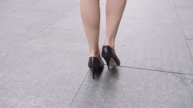 close up businesswoman feet in heels walking down pavement in city to work - high heels stock videos & royalty-free footage
