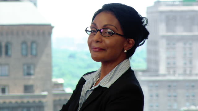 close up businesswoman with glasses in board room turning and smiling at camera/ new york, new york - native american ethnicity stock videos and b-roll footage