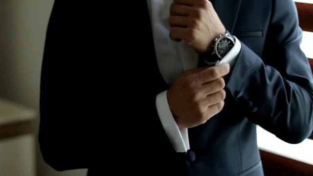 close up buttoning cuff-link on sleeve of white shirt - button down shirt stock videos & royalty-free footage