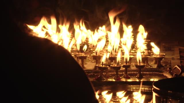 Close up, candles lit for Bunga Dyah Jatra