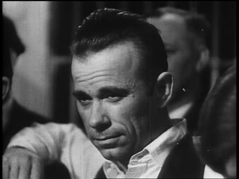 b/w 1934 close up captured john dillinger posing - john dillinger stock-videos und b-roll-filmmaterial