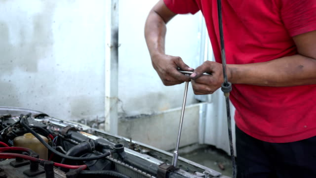 close up car mechanic is checking the engine lubrication system - lubrication stock videos & royalty-free footage