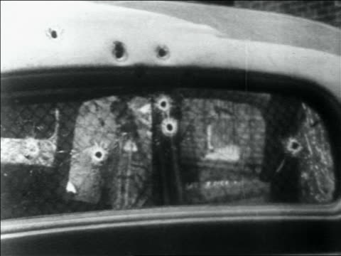 B/W 1934 close up car windshield with bulletholes / Bonnie and Clyde's car / Louisiana