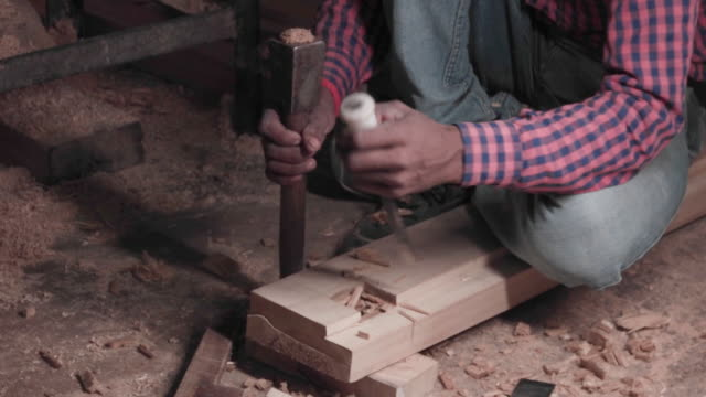 Close up, carpenter working with hand tools at his workshop