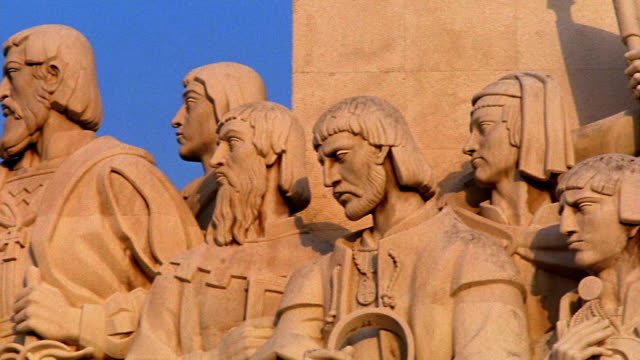 close up PAN carved figures on Monument to the Discoveries / Lisbon, Portugal