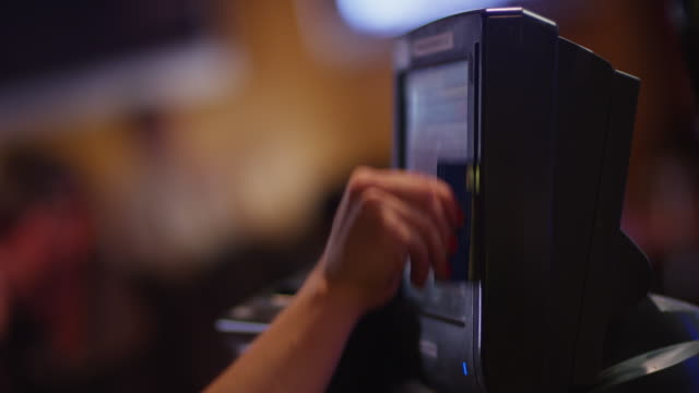 close up cash register screen, a restaurant servers hand rings up an invoice which is printed and placed in credit card folder. - red nail polish stock videos and b-roll footage