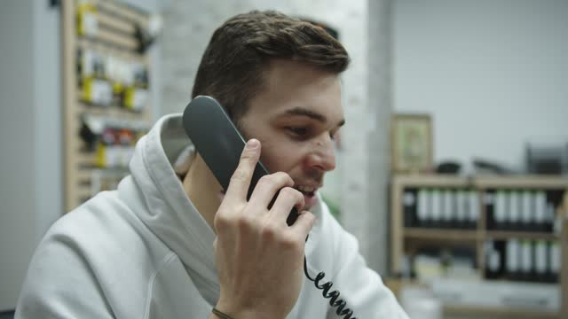 close up, caucasian man talking on the landline phone - landline phone stock videos & royalty-free footage