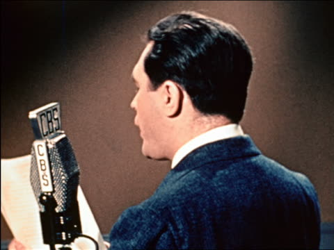 1941 rear view close up cbs radio announcer speaking into mike / industrial - radio stock videos & royalty-free footage