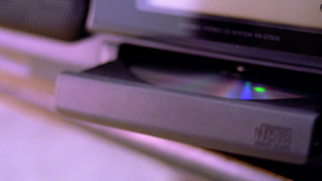 close up cd player / cd in tray closing - compact disc stock videos & royalty-free footage
