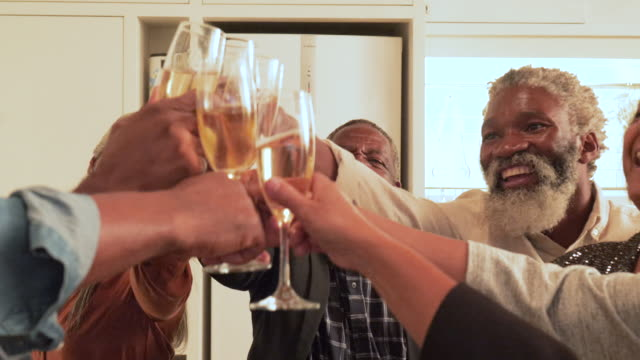 close up, celebrating african american man's birthday with champagne - 20 24 jahre stock-videos und b-roll-filmmaterial