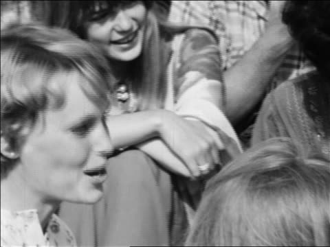 b/w 1968 close up pan celebrities sitting around maharishi maresh yogi outdoors / newsreel - mia farrow stock videos & royalty-free footage