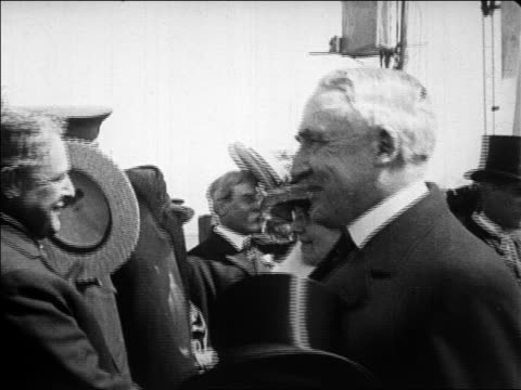 b/w 1923 close up charming president harding shaking hands with people / plymouth mass / newsreel - 1923 stock videos & royalty-free footage