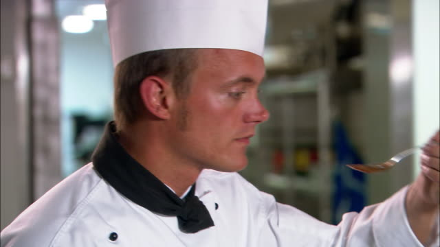 stockvideo's en b-roll-footage met close up chef tasting sauce / auckland, new zealand - proeven