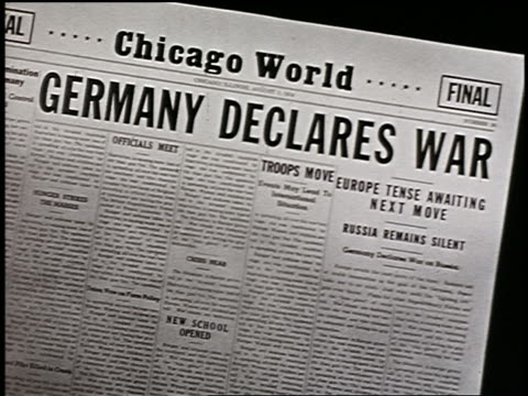vídeos de stock, filmes e b-roll de 1914 close up chicago world newspaper headline germany declares war / start of world war i - primeira página de jornal