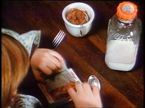 1958 overhead close up child opening mini box of raisin bran cereal, pouring milk + eating - raisin stock videos and b-roll footage