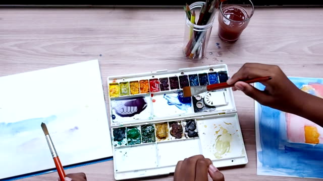 close up children hand painting water color - gouache stock videos & royalty-free footage