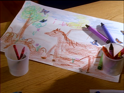 close up child's drawing of horse with crayons laying on it - pflanzenfressend stock-videos und b-roll-filmmaterial