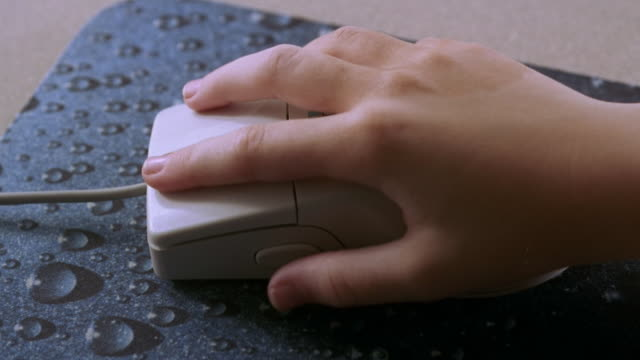 close up child's hand using computer mouse - computer mouse stock videos & royalty-free footage