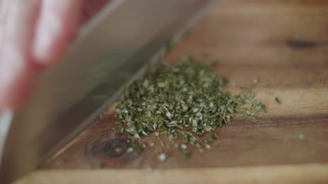 close up chopping freshness rosemary - erba aromatica video stock e b–roll