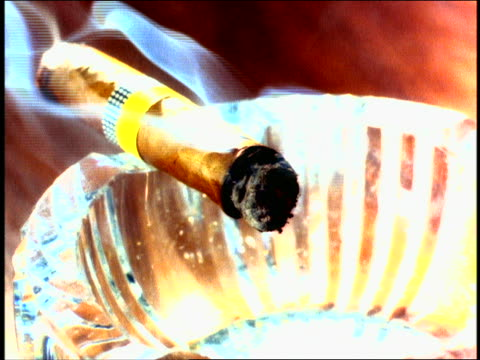 overexposed close up cigar sitting in ashtray / smoke rising up - overexposed stock videos & royalty-free footage
