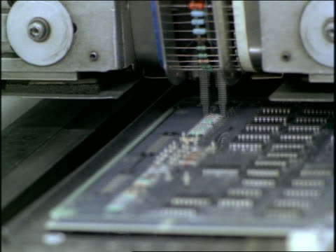 close up circuit board being built on assembly line in factory - halle gebäude stock-videos und b-roll-filmmaterial