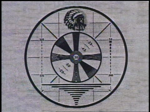 Close up circular test pattern with Native American man's head in headdress