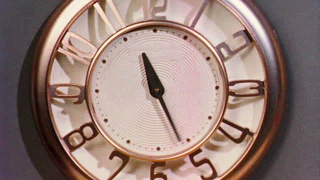 1958 close up clock with hands moving quickly counter-clockwise